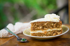 Slice of carrot cake on plate Royalty Free Stock Image