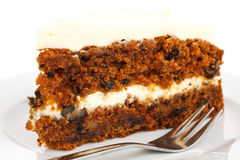 Slice of carrot cake with rich frosting. Royalty Free Stock Photography