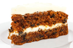 Slice of carrot cake with rich frosting. Stock Images