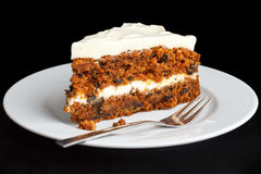Slice of carrot cake with rich frosting. Stock Photo
