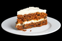 Slice of carrot cake with rich frosting. Royalty Free Stock Images
