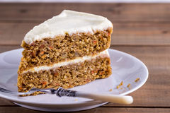 A slice of carrot cake on a white plate Royalty Free Stock Photography