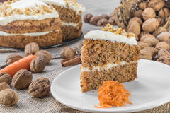 Slice of Carrot and Walnut Cake Topped with Cream  on Jute Backg Royalty Free Stock Images
