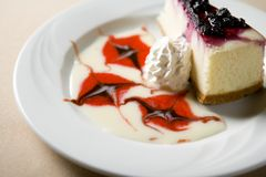 Slice of cheese cake. Photo of a slice of a cheese cake Stock Images
