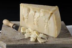 Slice of cheese Grana Padano Stock Photo