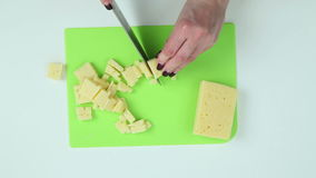 Slice the cheese into pieces stock video