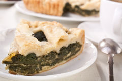 Slice of Cheese and Spinach Pie Stock Photography