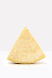 Slice of cheese on white Royalty Free Stock Photo