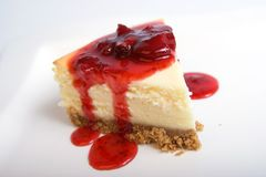 Slice of cheesecake. With strawberry topping,selective focus stock photography