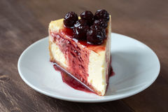 Slice of cheesecake with cherry compote Stock Photo