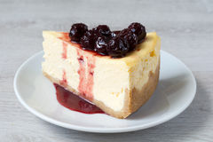 Slice of cheesecake with cherry compote Royalty Free Stock Image