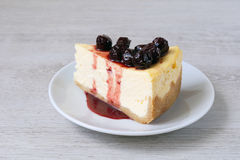 Slice of cheesecake with cherry compote Stock Photos