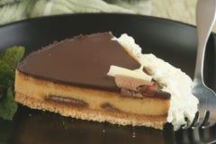Slice of cheesecake with cream Stock Photo