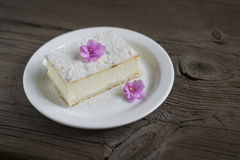 slice of cheesecake decorated with violets Stock Photography