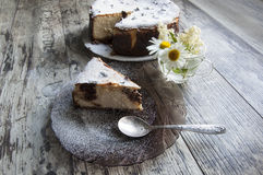 Slice of cheesecake on a glass dish Stock Photos