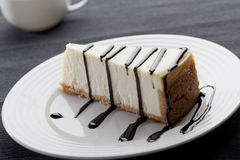 Slice of cheesecake with liquorice sauce Royalty Free Stock Image