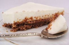 Slice of cheesecake. No cooking cheesecake with cookie crumbs Stock Photos