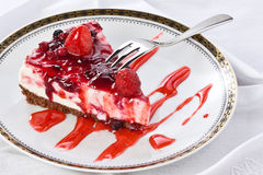Slice of Cheesecake on Plate with Sweet Fork royalty free stock photography