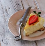 Slice of cheesecake with strawberries lying on a Royalty Free Stock Photography