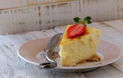 Slice of cheesecake with strawberries lying on a Royalty Free Stock Images