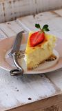 Slice of cheesecake with strawberries lying on a Royalty Free Stock Photo