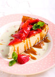 Slice of cheesecake with strawberry Stock Images