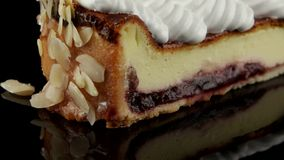 Slice of cheesecake with whipped cream stock footage
