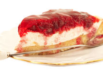 Slice of Cherry flan Cake on plate  over white Stock Photo