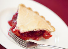 Slice of cherry pie. On a white plate Stock Images