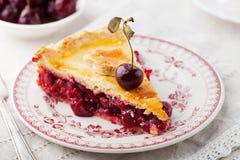 Slice of cherry pie with ice cream Stock Images