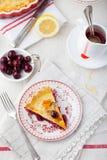 Slice of cherry pie with ice cream Stock Image