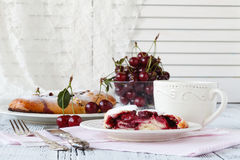 Slice of cherry pie with ice cream on a white textile background Royalty Free Stock Photos
