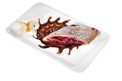 Slice cherry strudel on white ceramic plate rectangular shape. Stock Photos
