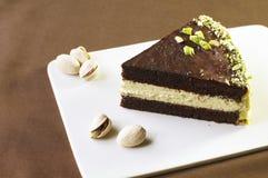 Slice of chocolate cake. With pistachio cream Royalty Free Stock Photos