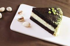 Slice of chocolate cake. With pistachio cream Stock Image
