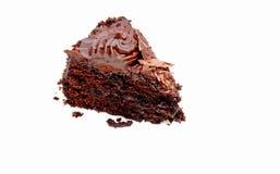 Slice Of Chocolate Cake. Triangular slice of chocolate cake on an isolated white background Stock Photo