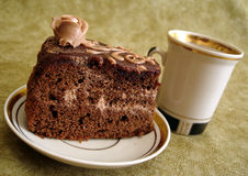 Slice of chocolate cake. On plate and cup Stock Image