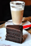 Slice of Chocolate Cake. And a Coffee Royalty Free Stock Images