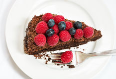 Slice of chocolate cake with berries Royalty Free Stock Photo