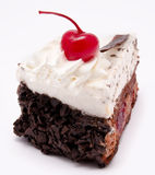 Slice of chocolate cake with cherry on the top isolated Royalty Free Stock Image