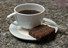 Slice of chocolate cake and coffee Stock Photos