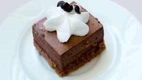 Slice of chocolate cake with cream. stock video