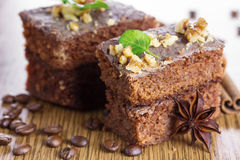 Slice of chocolate cake with nuts. Royalty Free Stock Images
