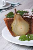 Slice of chocolate cake with  pears and mint vertical Stock Images