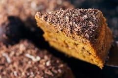 Slice of a chocolate cake raised up Royalty Free Stock Photos