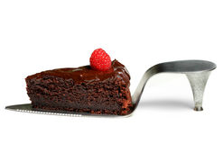 A slice of chocolate cake with raspberry on shoe cake server Stock Images