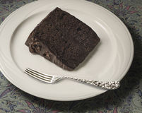 Slice of chocolate cake with silver fork Royalty Free Stock Image
