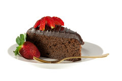 Slice chocolate cake with strawberries isolated Royalty Free Stock Image