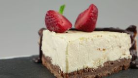 Slice of chocolate cheesecake stock video footage