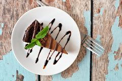 Chocolate cheesecake above view over rustic blue wood Stock Photography
